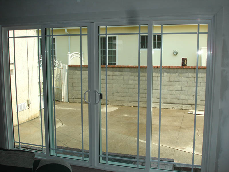 4 Panel 1733 with Queen Anne Grids – Vinyl Window Factory